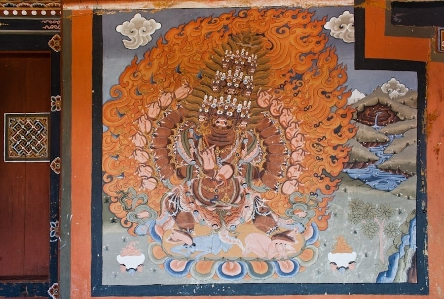 A Buddhist deity with 9 heads and 18 arms